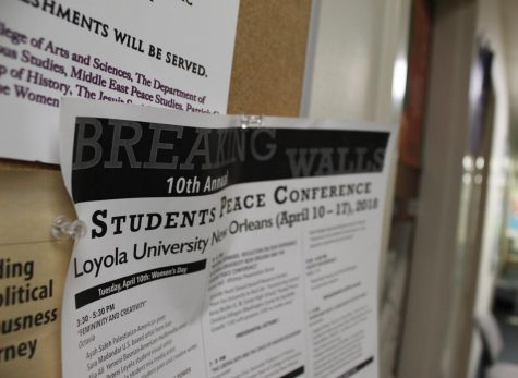 A peace conference flyer from 2018 hangs outside of the office of the director of Middle East peace studies. The peace conference takes place this year starting March 29. Photo credit: Gabriella Killett