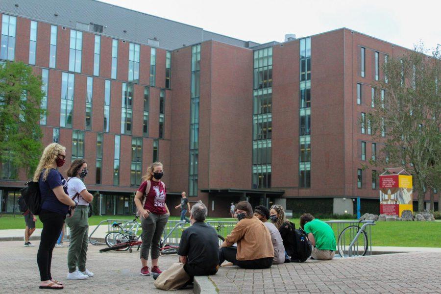 Students+sit+outside+Monroe+Hall.