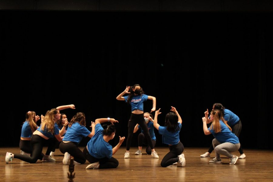 Students perform during the air band competition hosted between Greek life organizations.