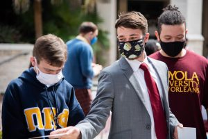 Christian Martinez, right, and Aidan Gibson, left, campaign for SGA president and vice president respectively during a Peace Quad campaign event. The pair was disqualified from the SGA race after being found guilty of multiple campaign violations.