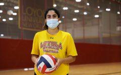 Helene Masone, Loyola volleyball senior, poses in The Den.