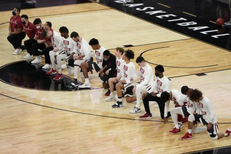 Washington State players kneel during the national anthem before an NCAA college basketball game against Arizona State in the first round of the Pac-12 mens tournament Wednesday, March 10, 2021, in Las Vegas. (AP Photo/John Locher)