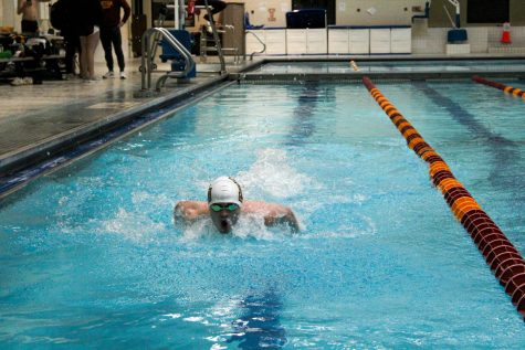 Junior Streett Martin swims laps at swim team practice on Feb. 12. The Wolf Pack men