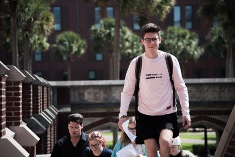 In this September 2019 file photo, members of student group Lxyno for Sexual Health march up the steps of Marquette Hall. Lxyno for Sexual Health, which is not officially affiliated with Loyola, advocates for access to sexual education and health resources on campus. Photo credit: Michael Bauer