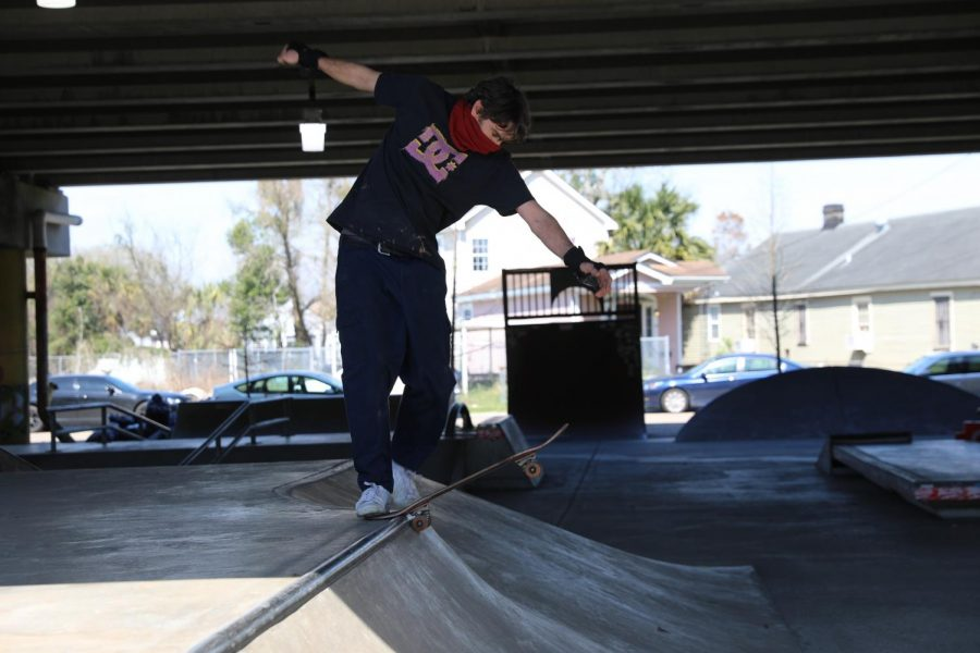 A skateboarder prepares to skate down a ramp at Parisite DIY Skatepark. Skateboarders have many options to build their skating skills at places like this.