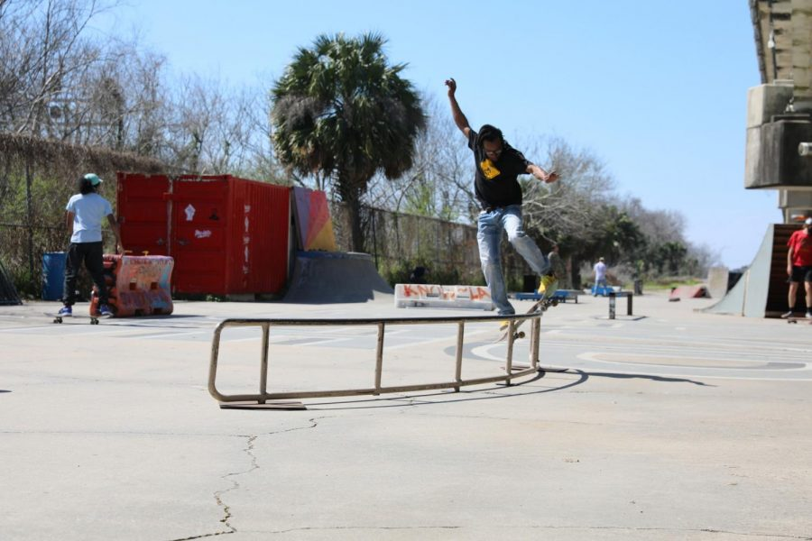 A skaterw grinds on a quarterpipeat a Parisite DIY Skatepark. Skateboarders find a community with others at places like this.