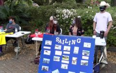 Members of the Loyola sailing club table in front of the Danna Center on March 30, 2021. Club sports teams use tabling to drum up student interest. Photo credit: Jabez Berniard