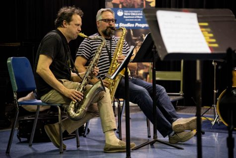 Jazz faculty member Jason Mingledorff, left. and Brent Rose rehearse with the New Orleans Nightcrawlers. The group recently won a Grammy in the new category of Best Regional Roots Album. Photo credit: Michael Bauer