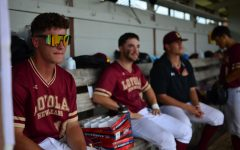 Loyola baseball players watch their teammates from the dugout during a 5-2 win against Brewton-Parker on April 9. Wolf Pack baseball made the NAIA top 25 poll for the first time since the program was reinstated in 1991. Photo credit: Gabrielle Korein