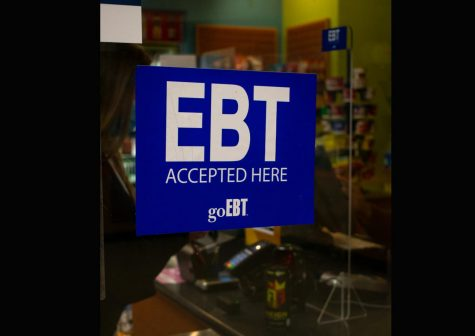 An EBT sticker sits in the front window of Loyola
