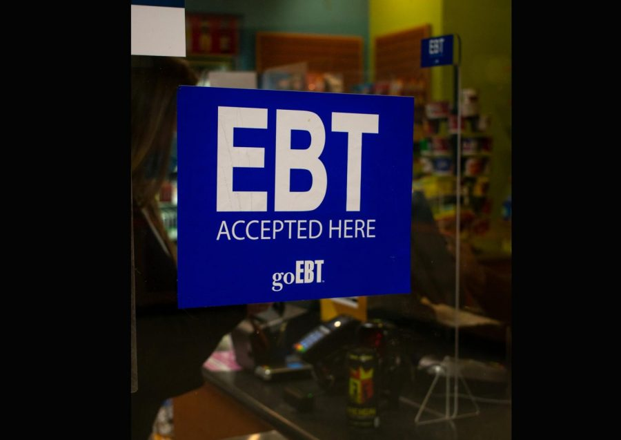 An EBT sticker sits in the front window of Loyola's C-Store to indicate that the store accepts SNAP benefits from students that participate in the program. This is one of the methods Loyola is using to combat food insecurity on campus. Photo credit: Maria Paula Marino