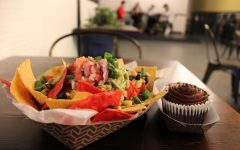 A nacho plate appetizer (left) and a chocolate cupcake (right) are two