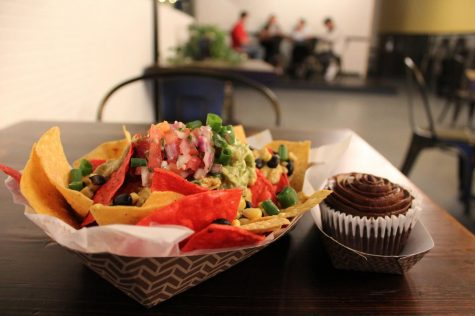"A nacho plate appetizer (left) and a chocolate cupcake (right) are two ""comfort food"" items featured on Kindred"