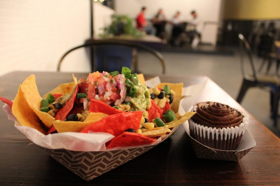 A+nacho+plate+appetizer+%28left%29+and+a+chocolate+cupcake+%28right%29+are+two+%22comfort+food%22+items+featured+on+Kindred%27s+fully+vegan+menu.+Kindred+is+located+on+Maple+Street+and+is+a+near+15+minute+walk+from+main+campus.+Photo+credit%3A+Shadera+Moore