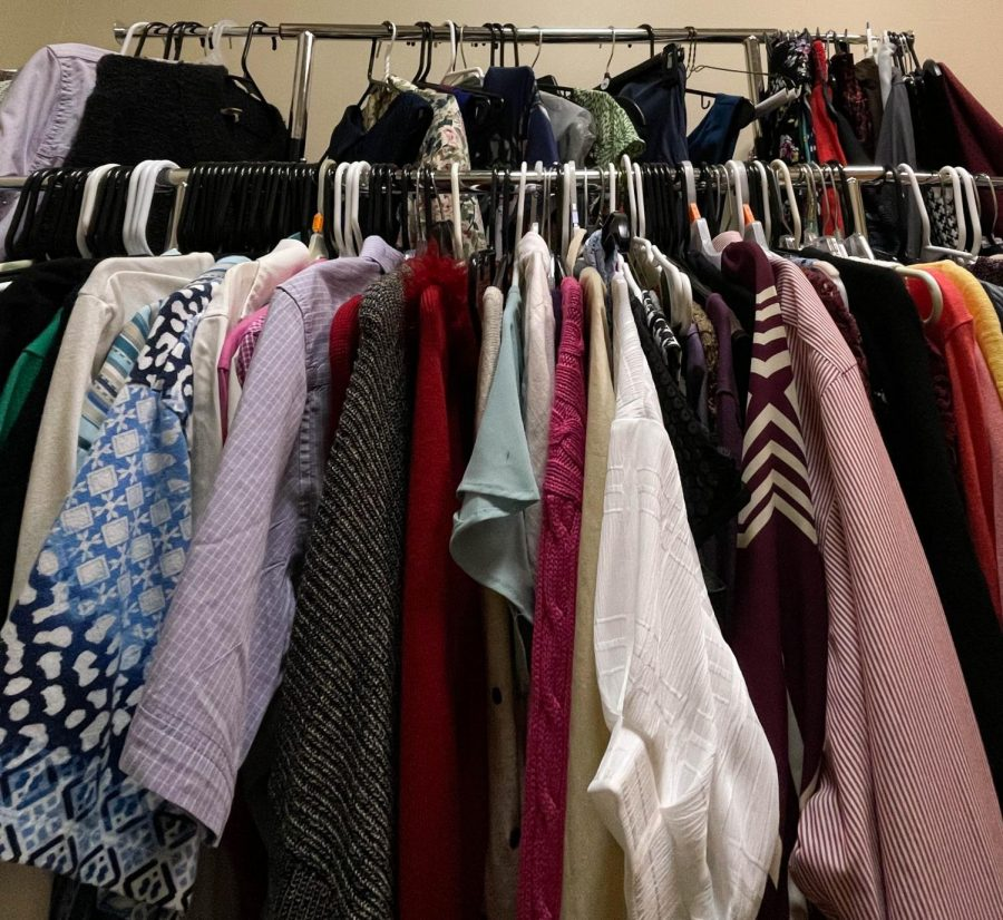 Clothes hang in Loyola's Wolfpack Wardrobe. The on-campus closet began as a way to provide professional clothing to students. Photo credit: Erin Haynes