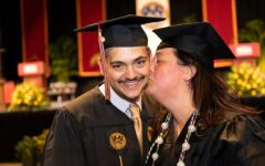 Aimee Towne and her son, Cameron Kelley, at their graduation ceremony, Saturday, May 15, 2021. Both received their Bachelor's degrees this spring. Courtesy of the Loyola University New Orleans Facebook page. Photo credit: Kyle Encar