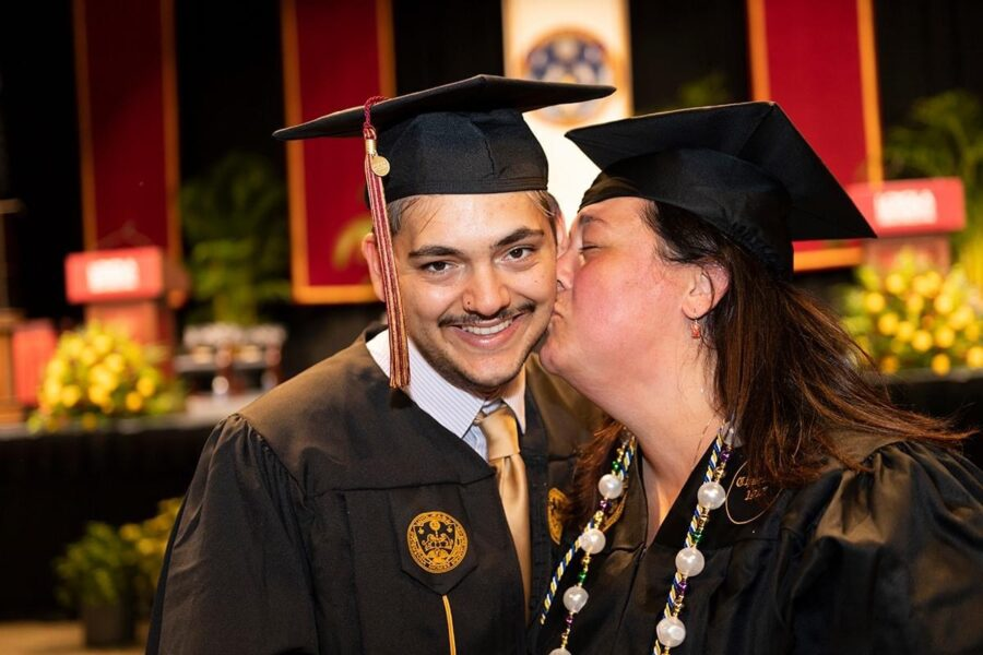 Aimee Towne and her son, Cameron Kelley, at their graduation ceremony, Saturday, May 15, 2021. Both received their Bachelors degrees this spring. Courtesy of the Loyola University New Orleans Facebook page. Photo credit: Kyle Encar