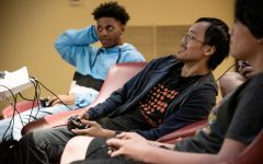 Gaming club President Quinton Liang (center) plays Super Smash Bros in Satchmo's Lounge.