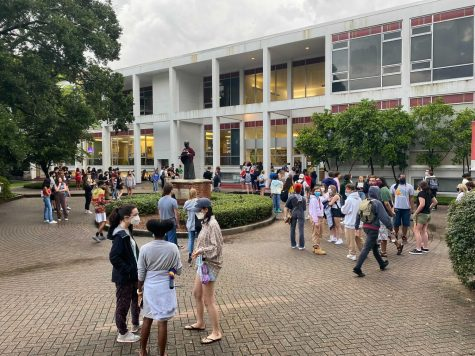 Students gather outside the Danna center after a fire alarm went off in Carrolton Hall.