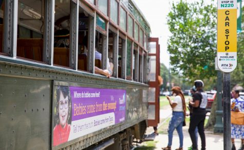 Students wait to board the Saint Charles streetcar in front of Loyola and Tulane University on Aug.17th, 2021.