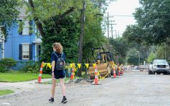 A student walks through a roadwork site on Freret street, Aug. 11, 2021. The roadwork, which is expected to continue through September, has caused Loyola students to rethink their parking plans.