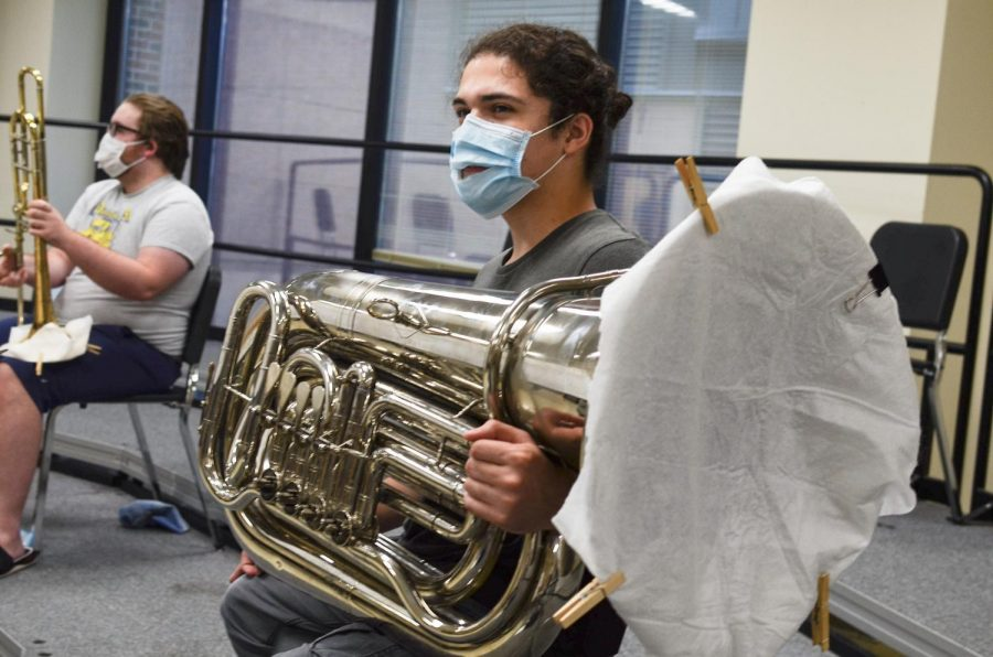 Senior music major Albert Bustillo sits with his tuba during a brass quintet rehearsal.