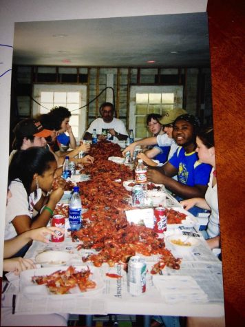 Loyola students gather at a crawfish boil after Hurricane Katrina in 2005 in History chair Mark Fernandez