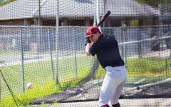 Payton Alexander prepares to bat at practice on Monday, Oct. 11, 2021