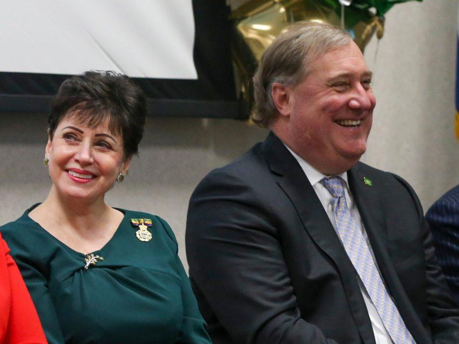 Gayle Benson sits next to Dennis Lauscha.