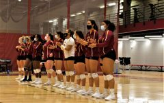Members of the Loyola Volleyball team line up after a win.