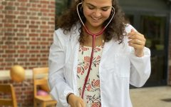 Grace Lalomia tries on her stethoscope outside of Bobet Hall on Saturday, Oct. 2, 2021.