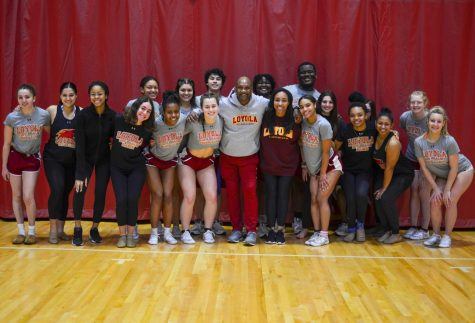 Rickey Hill with members of the 2019-2020 cheer and dance teams.