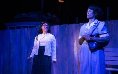 Brianna Thompson stands onstage, looking at her fellow actor in Caroline or Change